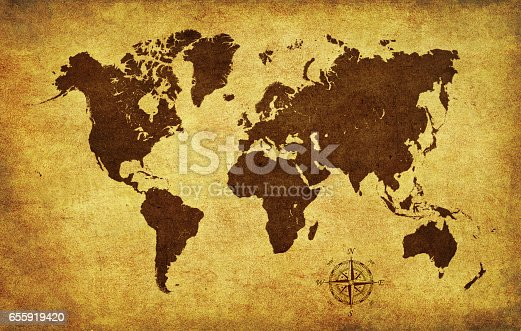 istock Brown World map on old parchment with compass 655919420