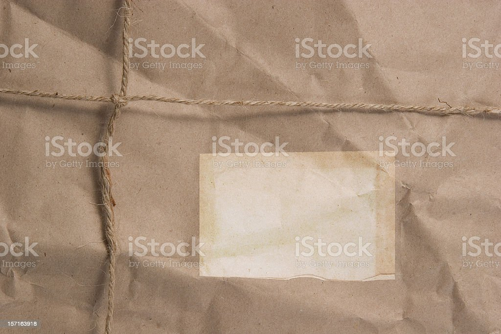Brown Wrapped Package with Label royalty-free stock photo
