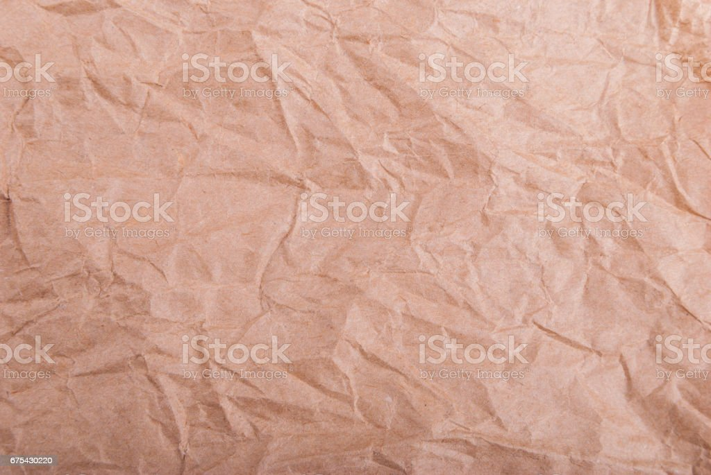 Brown wrinkled wrapping paper . royalty-free stock photo