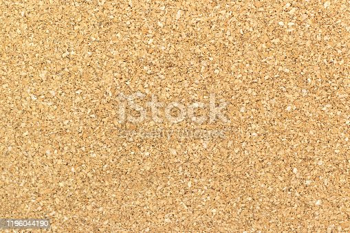 990092558 istock photo Brown yellow color of cork board textured background 1196044190