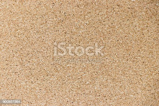 990092558 istock photo Brown yellow color of cork board textured background 900857364
