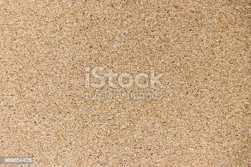 990092558 istock photo Brown yellow color of cork board textured background 969654428