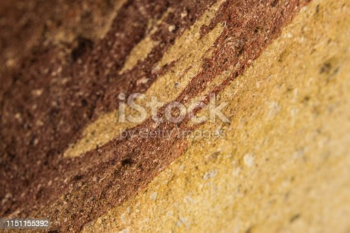 istock brown yellow stone background for text in focus 1151155392