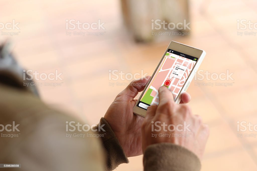 Brown young man map smartphone stock photo