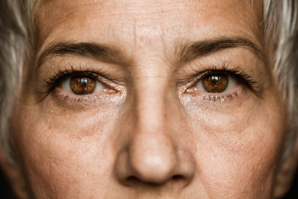 Brown-eyed senior woman. stock photo