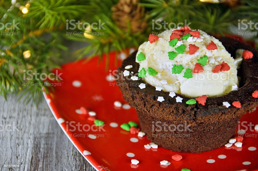 brownie bowl with Christmas sprinkles on ice cream stock photo