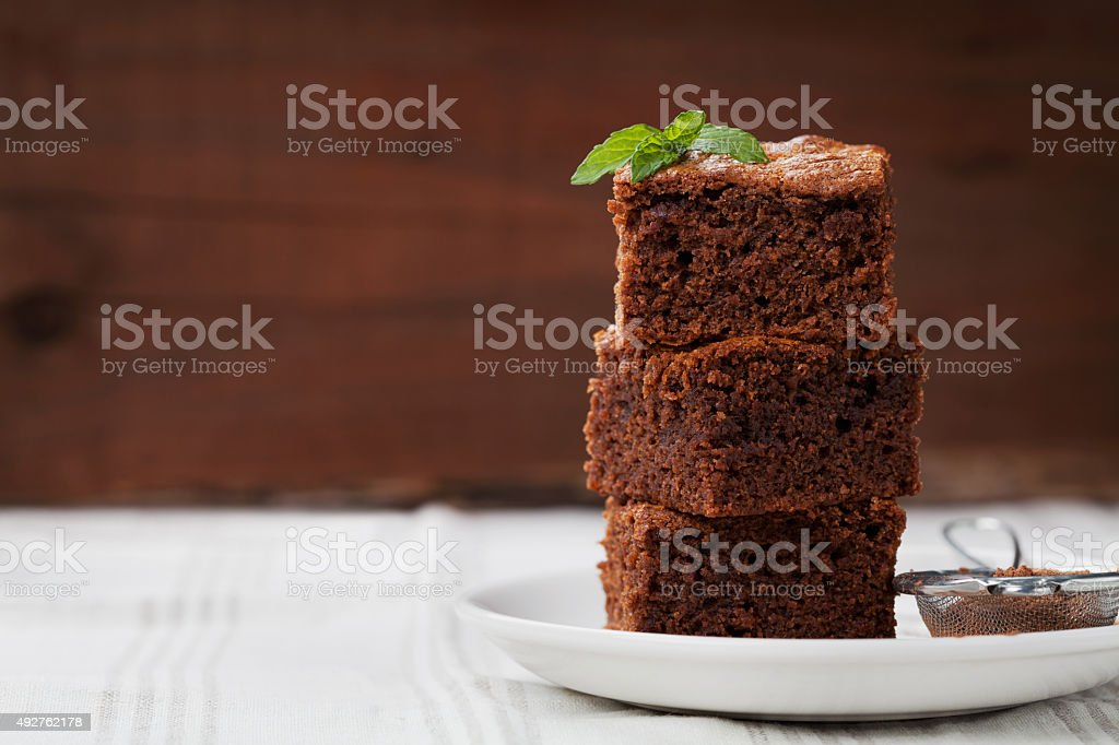 Brownie, chocolate cake or pie, cacao dessert with mint stock photo
