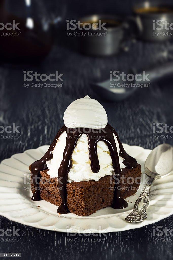 Brownie Sundae with Vanilla Ice Cream and Chocolate Sauce stock photo