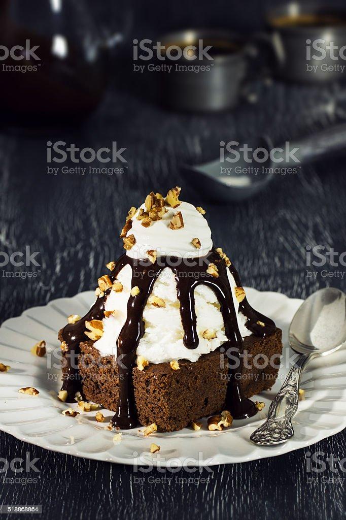 Brownie Sundae with Vanilla Ice Cream, Chocolate Sauce, and Nuts stock photo