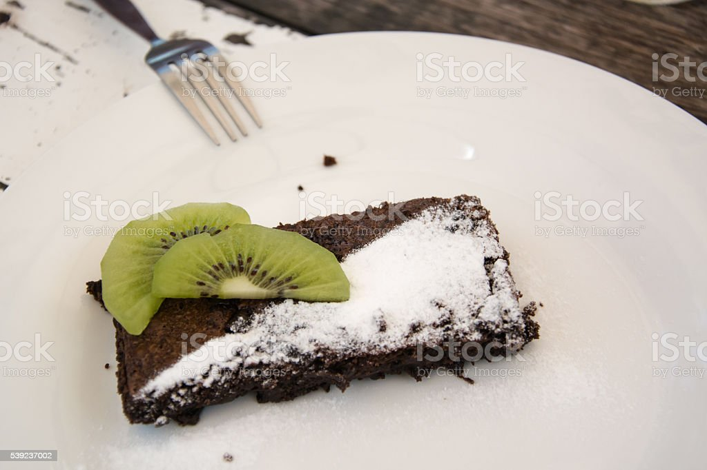 Brownie with kiwi and icing royalty-free stock photo