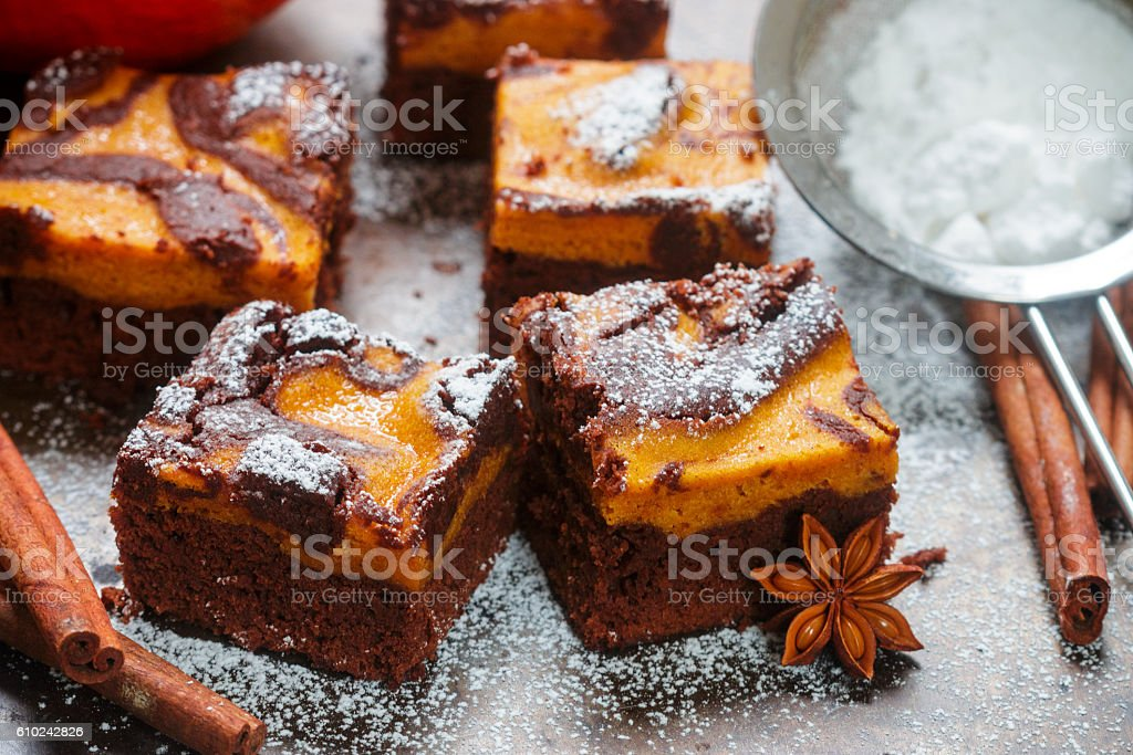 Brownie with pumpkin and chocolate. American kitchen. Rustic style stock photo