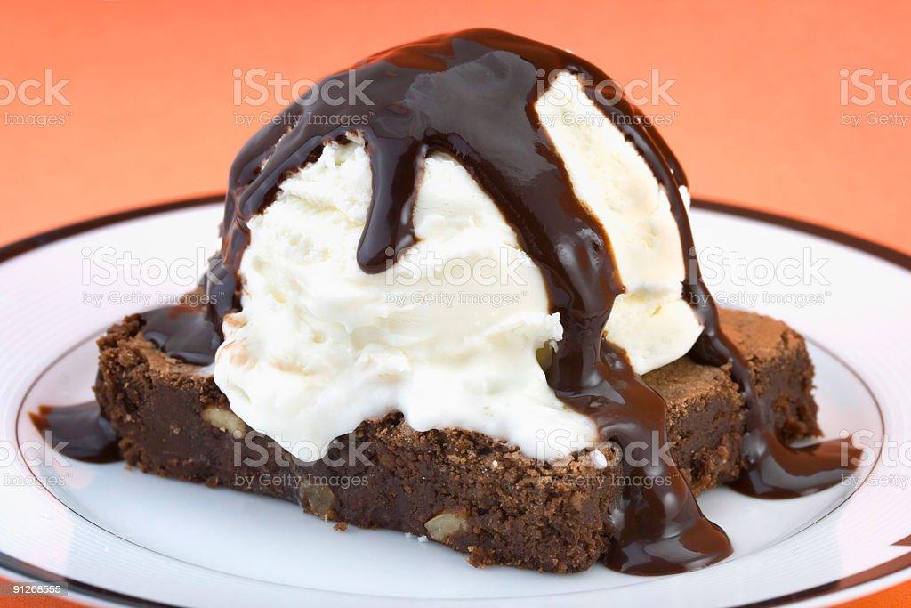 Brownie with vanilla ice cream and hot fudge sauce stock photo