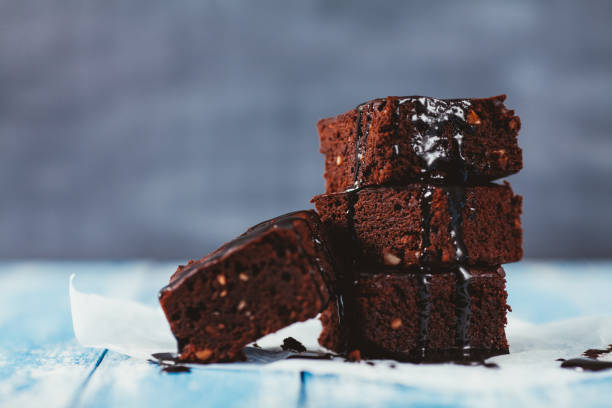 Brownies with Chocolate Sauce - foto stock