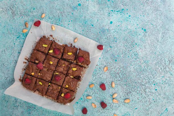 Brownies with dark chocolate, raspberries and sea salt. stock photo