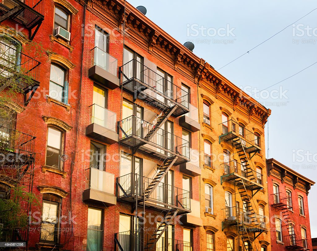 brownstone apartment buildings in brooklyn at sunset royalty free stock photo