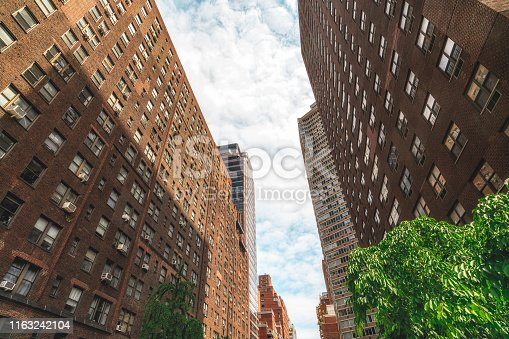 490774222istockphoto Brownstone Buildings in New York City, Low Angle View. Lower Manhattan Architecture 1163242104