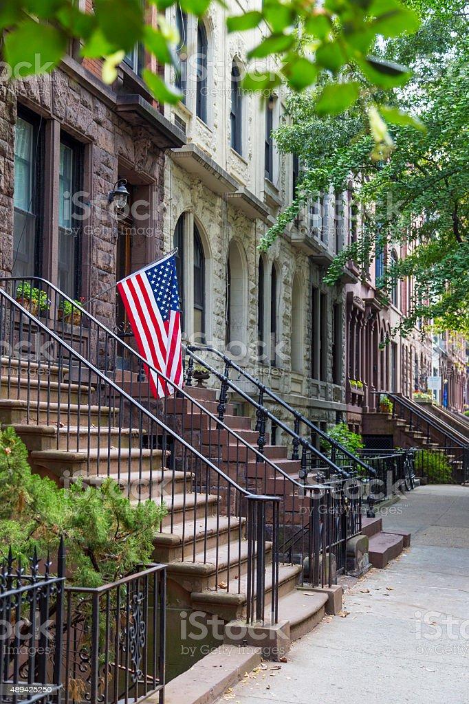 Brownstone houses in urban residential neighborhood of Brooklyn stock photo