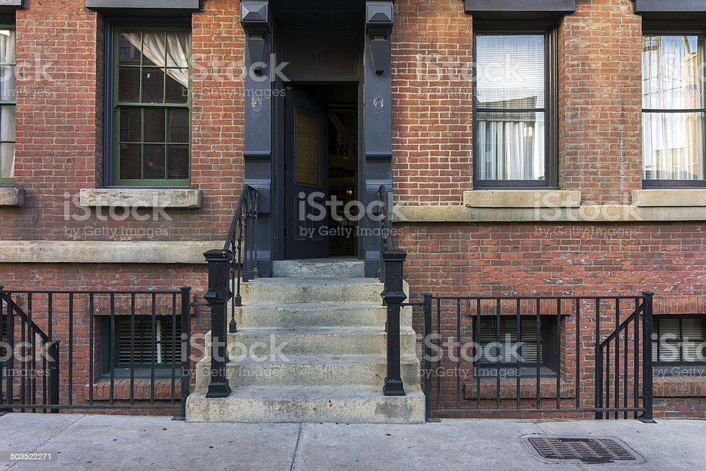Brownstone stoop with open door. stock photo