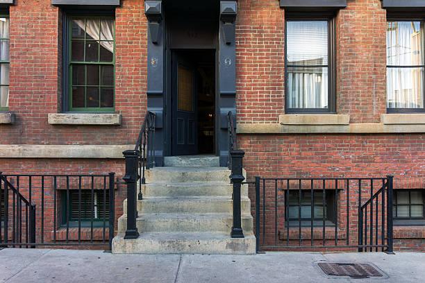 Brownstone stoop with open door. stock photo
