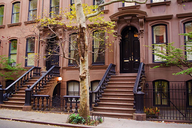 brownstones new york city - terraced houses stock photos and pictures