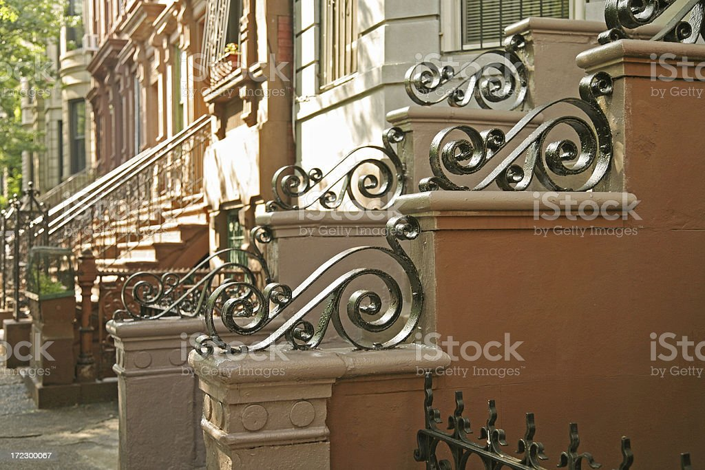 "Brownstones With Wrought Iron Details ""Staircases outside brownstone homes in Hamilton Heights, New York City, NY, USA."" 20th Century Style Stock Photo"