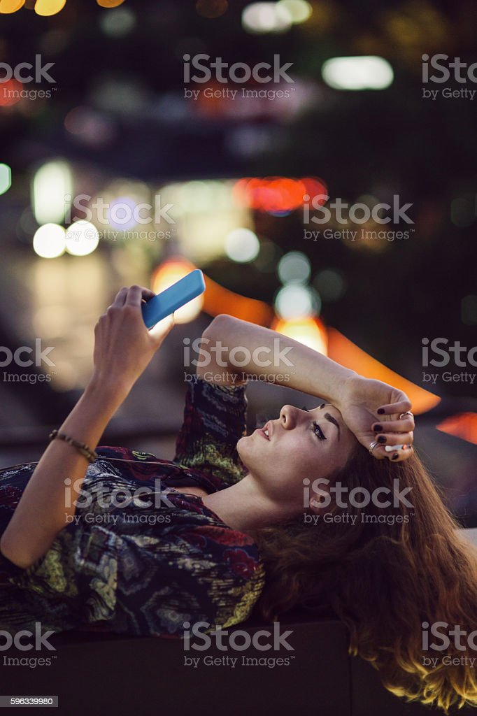 Browsing on a cell phone stock photo