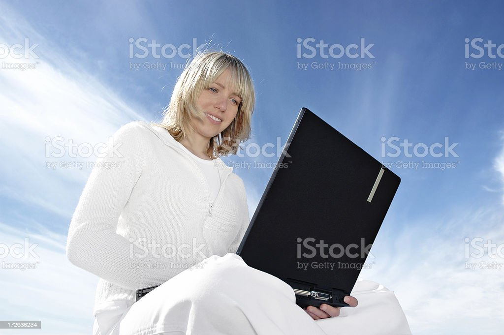 Browsing on laptop royalty-free stock photo