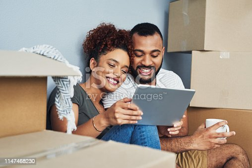 istock Browsing online for some home decorating ideas 1147468230