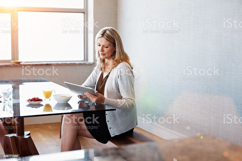 Browsing over a healthy breakfast stock photo