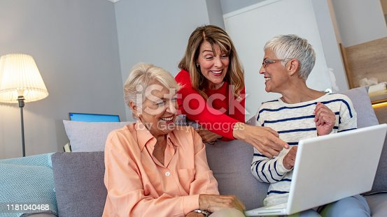 1053414472istockphoto Browsing some old photos on the laptop. 1181040468