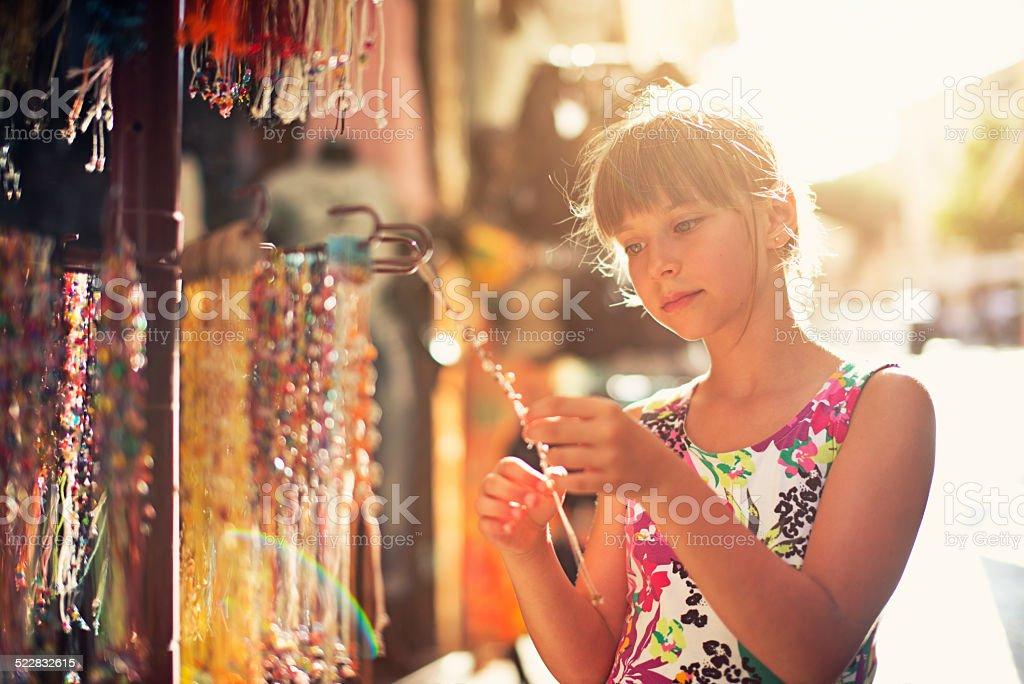 Browsing street jewelry stand stock photo