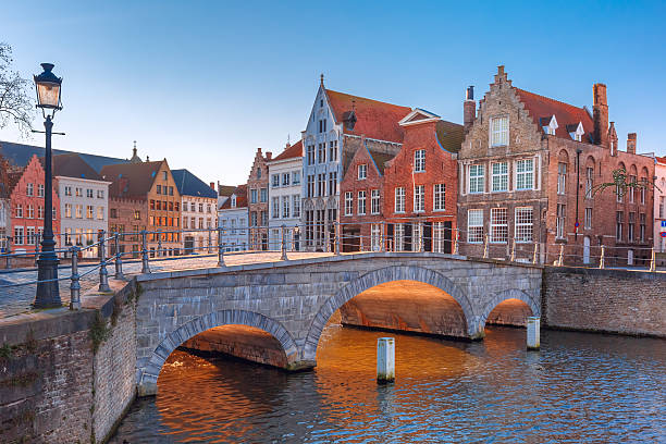 Bruges canal and bridge in the morning, Belgium stock photo