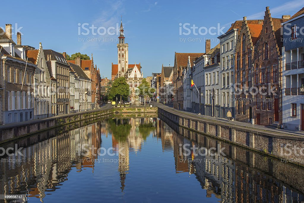 Bruges - Canal and Burghers lodge building in morning light. stock photo