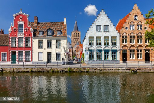 View of the Spiegel Rey canal and facades of old medieval houses on a sunny day. Brugge. Belgium.