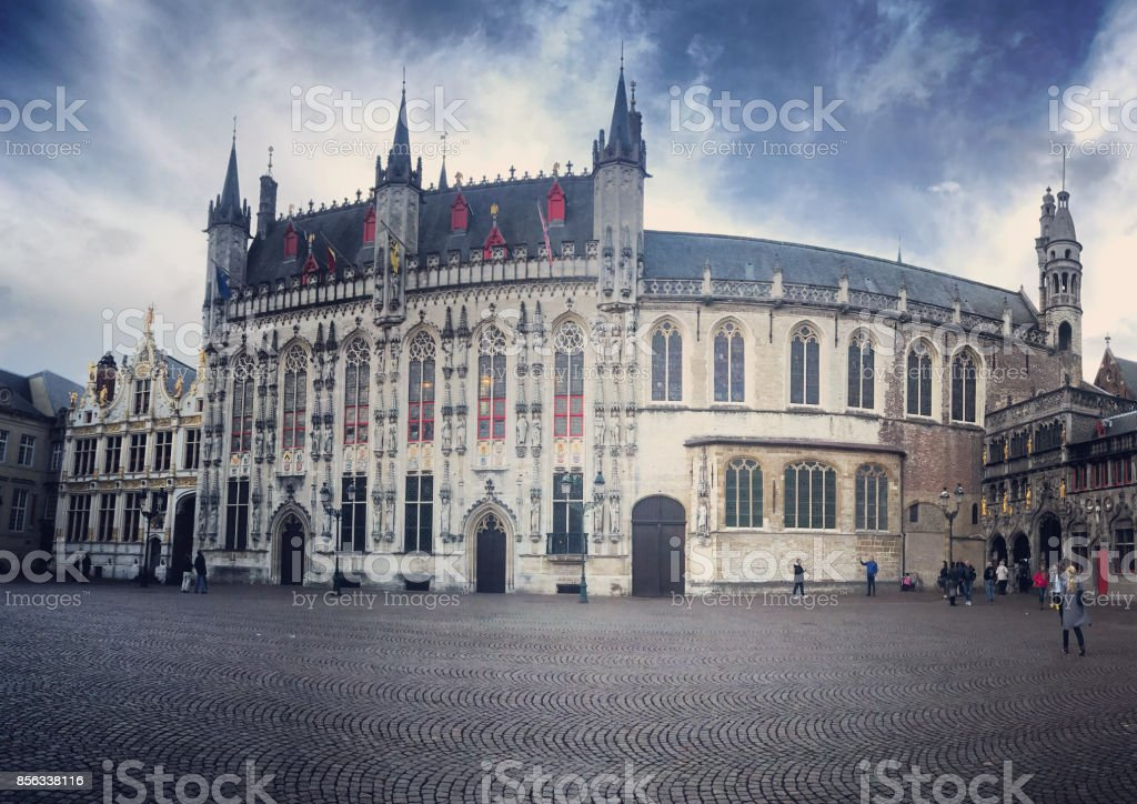 Bruges City Hall on Burg Square with tourist sightseeing, Belgium stock photo