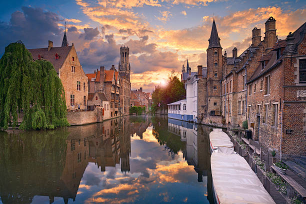 Bruges. Image of famous most photographed location in Bruges, Belgium during dramatic sunset. belgium stock pictures, royalty-free photos & images