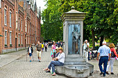 Bruges tourists with water fountain