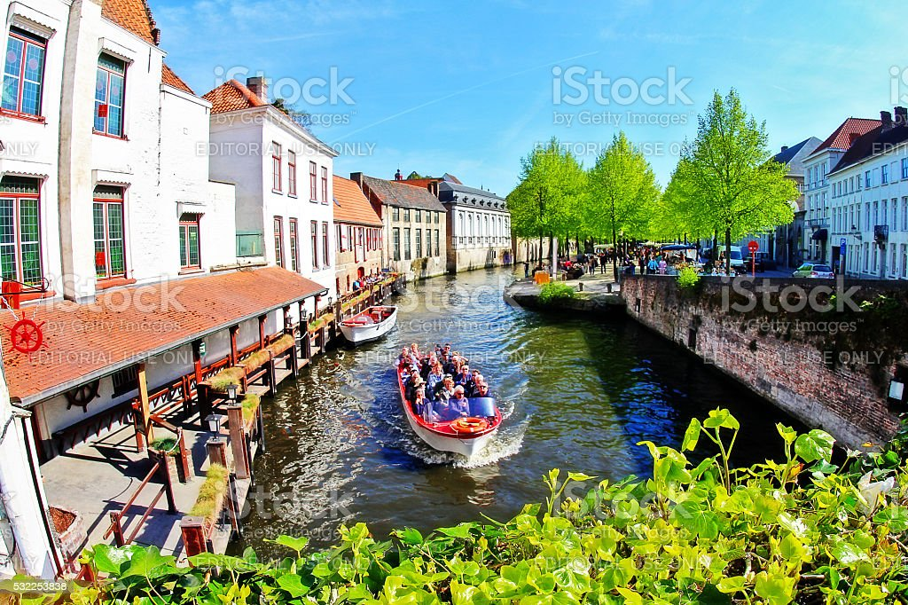 Brugge, Belgium - May 06, 2016 - Sightseeing along canal in Brugge stock photo