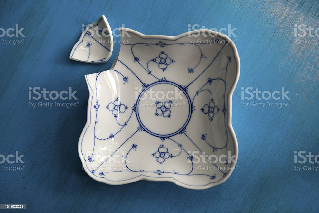 Bruised, blue plate royalty-free stock photo