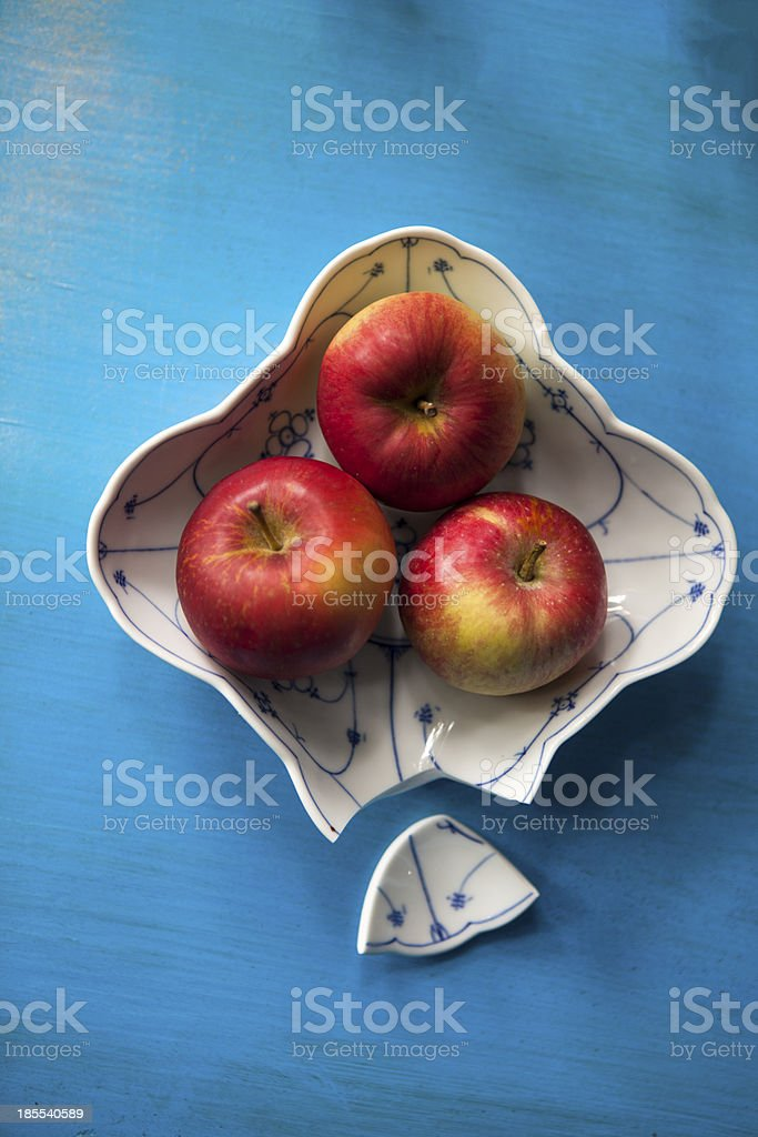 Bruised my prettiest blue plate with apples royalty-free stock photo