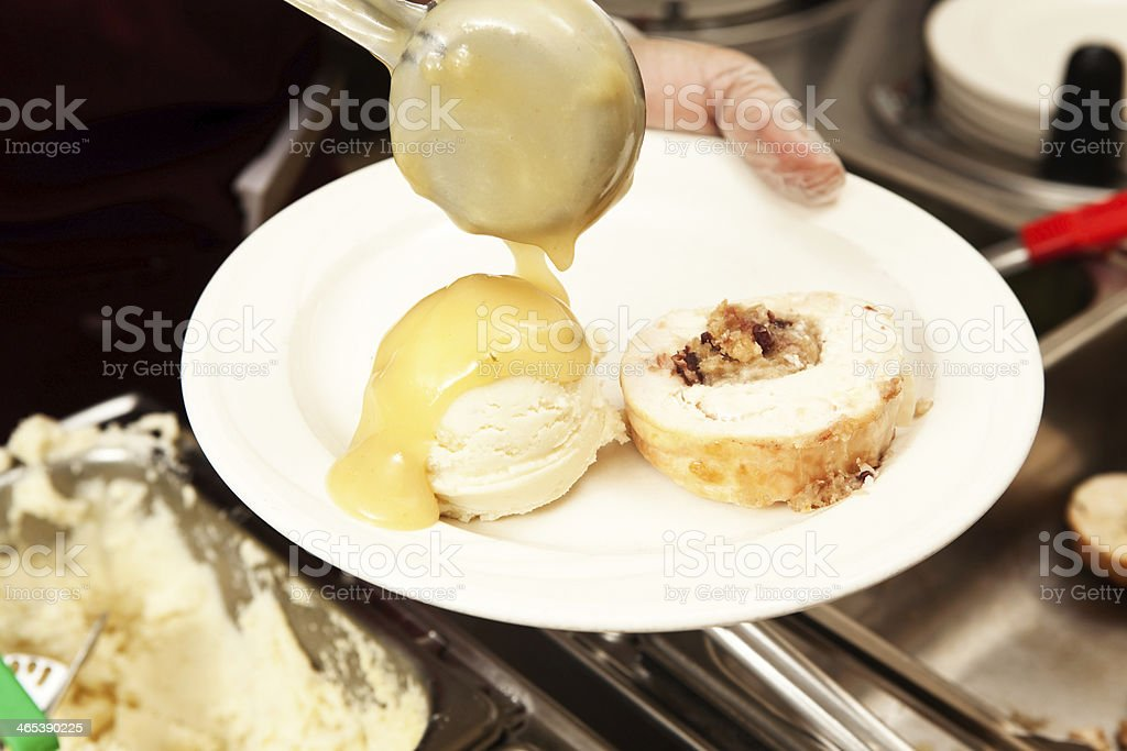 Brunch Buffet Serving Mashed Potatoes with Gravy from Ladle stock photo