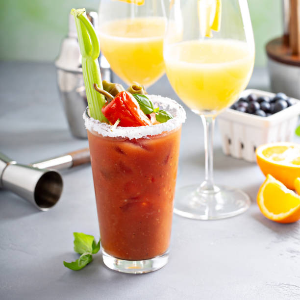 Brunch cocktails with mimosas and bloody mary stock photo