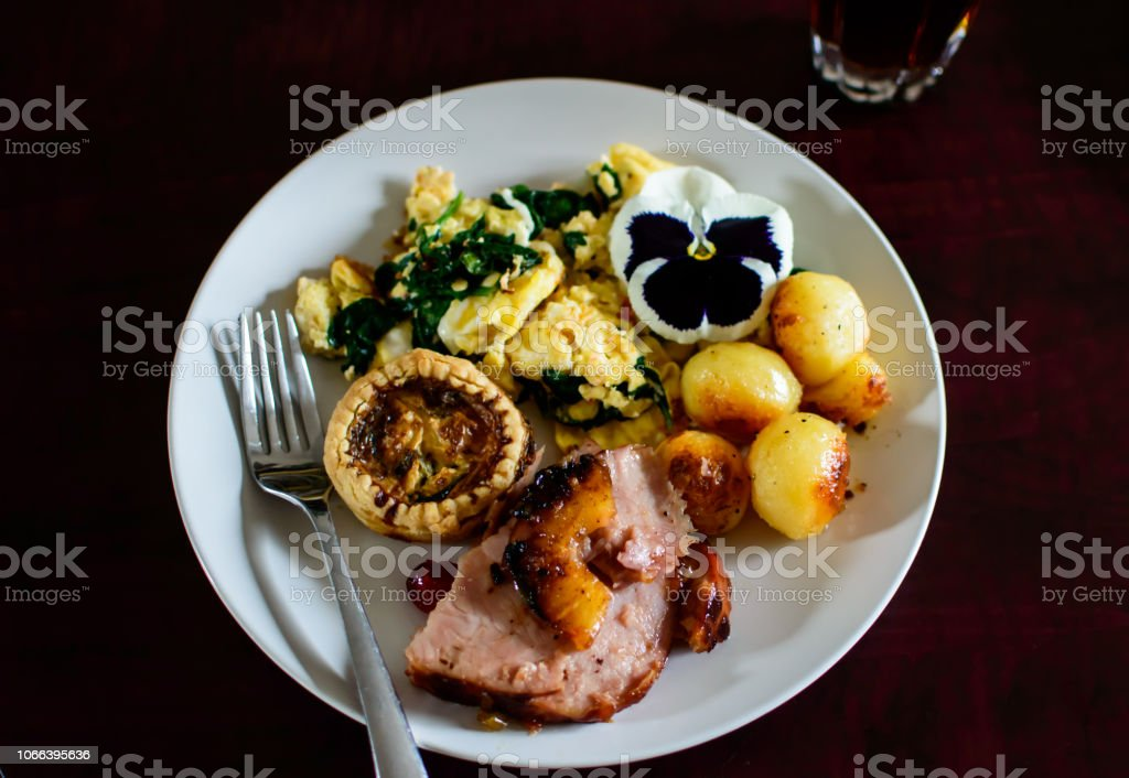Brunch flat lay food with Parisienne potatoes, Scrambled eggs. quiche and ham with pineapple elegant brunch stock photo