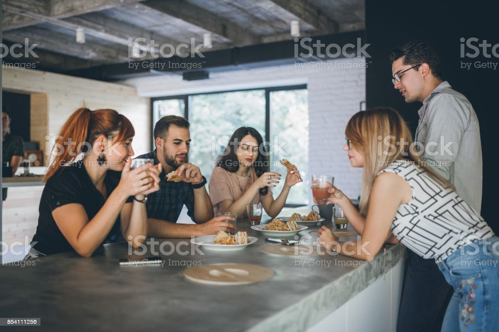 Brunch time in office stock photo