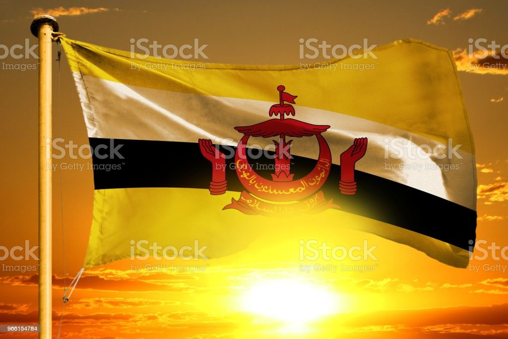 Brunei Darussalam flag weaving on the beautiful orange sunset with clouds background - Royalty-free Bright Stock Photo