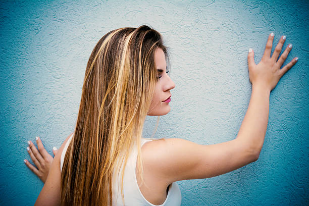 Brunete with highlights Beautiful teenage girl with highlights posing next to the wall highlights hair stock pictures, royalty-free photos & images