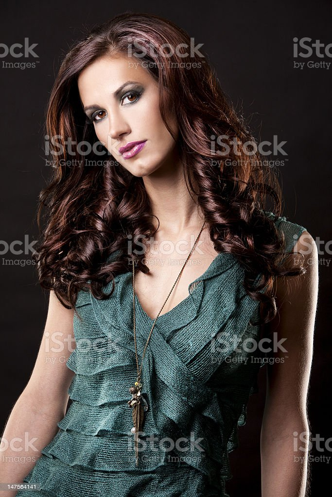 brunette and green dress royalty-free stock photo