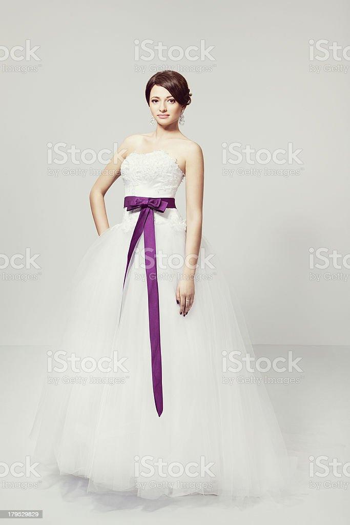 Brunette bride in white wedding dress stock photo