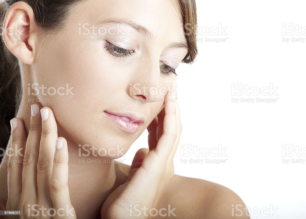 Brunette, caucasian woman feeling her face royalty-free stock photo