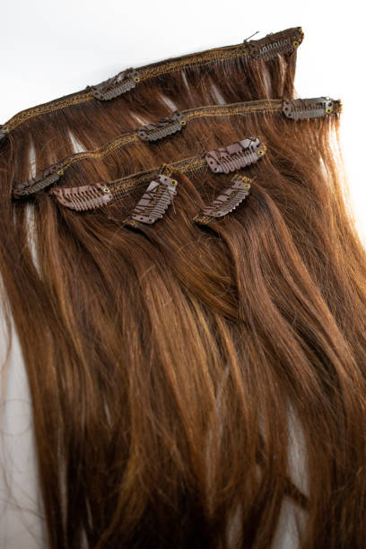Brunette clip in hair extensions with clips stock photo